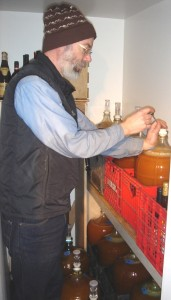 It's cold in the cold room. Wade checks on how fermentation is progressing.