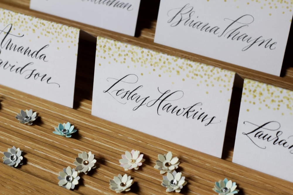 Calligraphy name cards and paper flowers