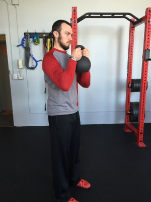 Hold the kettlebell in the goblet position and go for a brutal walk.