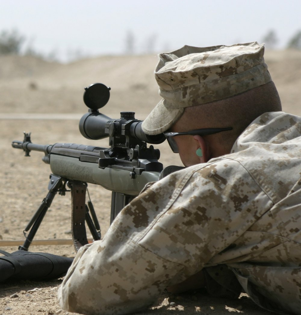 CAMP BAHARIA, Iraq � A Marine with 2nd Fleet Anti-Terrorism Security Team Company, Marine Corps Security Force Battalion, prepares to fire his M14 DMR sniper rifle during a battle sight zero exercise here April 21.  Unit members practiced adjusting their weapons� sights and firing the rifles aboard 1st Battalion, 6th Marine Regiment�s range here to maintain their proficiency while providing security for convoys here.