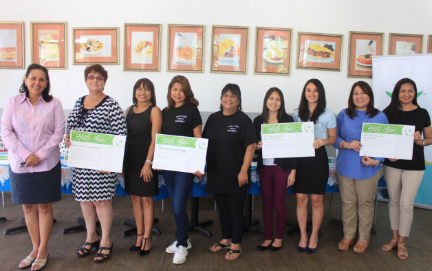 A HÅFA ADAI PLEDGE CEREMONY WAS HELD FEBRUARY 26 AT THE KRACKED EGG IN TUMON. From Left: Telo Taitague, GVB, deputy general manager; Nancy Xania Barnhouse, Island CERTS Corporation, president; Annmarie T. Muna, The Kracked Egg, owner; Lory Tydingco, The Kracked Egg, owner; Antonita Blas, The Kracked Egg, owner; Flora Weakley, F.L. Enterprises Inc. dba: Neni & Me, owner; Laura Cepeda, F.L. Enterprises Inc. dba: Neni & Me, owner; Maria Ramos, Zero Gravity LLC, dba; GoPlay, general manager and Sandra Silverio Chan, Zero Gravity LLC, dba; GoPlay, co-owner proudly display their newly signed Håfa Adai Pledge.