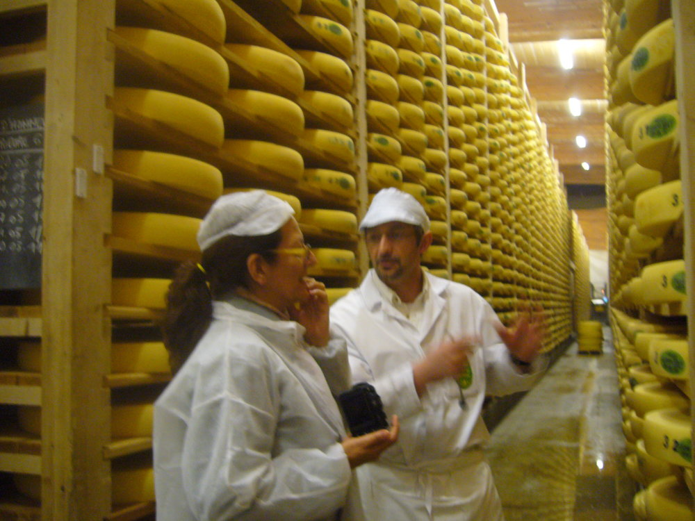 Benjamin's cheese mentor Daphne Zepos amongst thousands of wheels of Comte