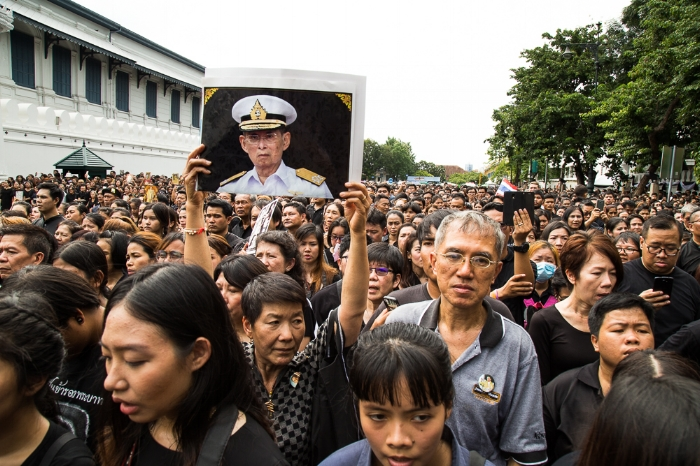 Crowd gathers in front of the Royal Grand Palace in Bangkok to sing the new anthem due to the loss of King Bhumibol Adulyadej