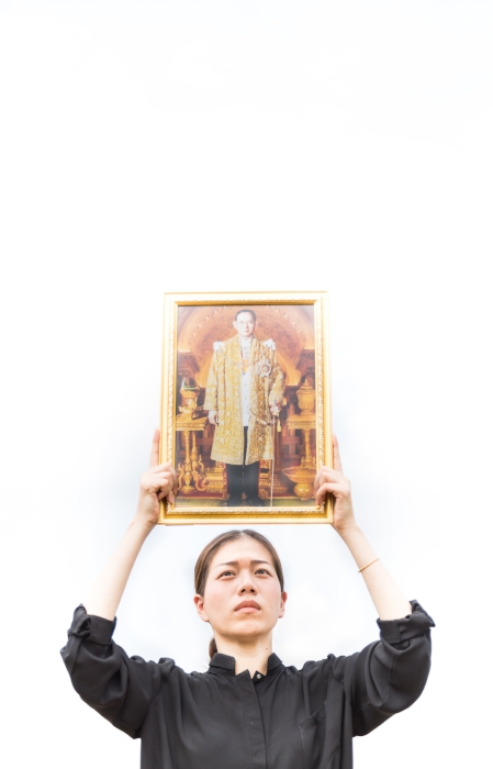 Mourner takes picture with a picture a of King Bhumibol Adulyadej