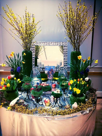 """pictured above is the traditional haft seen--seven items starting with the letter """"s"""" are placed to symbolize rebirth, affluence, love, health, patience, beauty and a colorful sunrise"""
