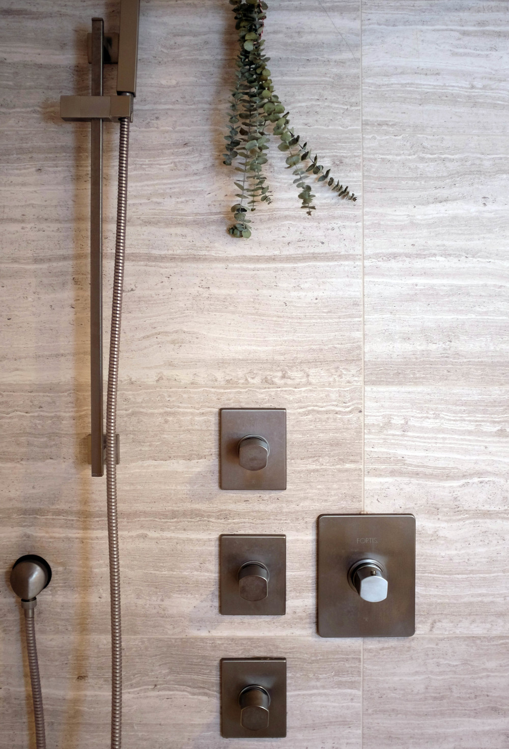A detail of the Fortis fittings. As a side note, adding a bunch of fresh eucalyptus into your shower creates a wonderful spa experience as the aroma comes out with the steam. Also, it just looks pretty.