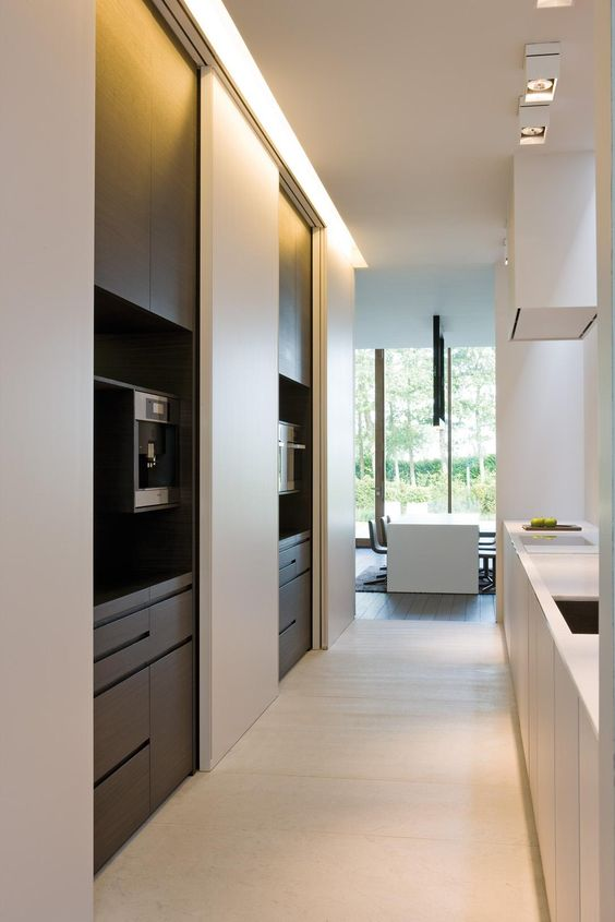 This is a similar concept to close up the visual clutter. The full height sliding doors take all the appliance screens, appliances and objects and hide them so the space is serene and put together when not in use. To achieve this look you can utilize one of the  Hafele  HAWA system sliding door hardware sets and track. Hafele makes many sliding door hardware options depending on the door dimensions and weight. I like to recess the track so the bottom is flush or slightly recessed in the ceiling for a clean look.
