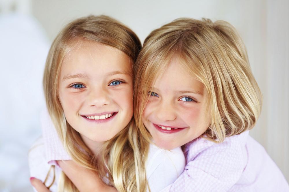 girls sisters smile hug.jpg