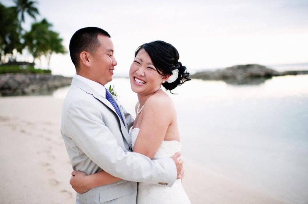 bride and groom on the beach hawaii hair and makeup cost on oahu honolulu to see reviews from events