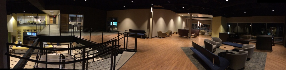 Panoramic view of 2nd floor with parent rooms on left and lobby/sitting area on right.