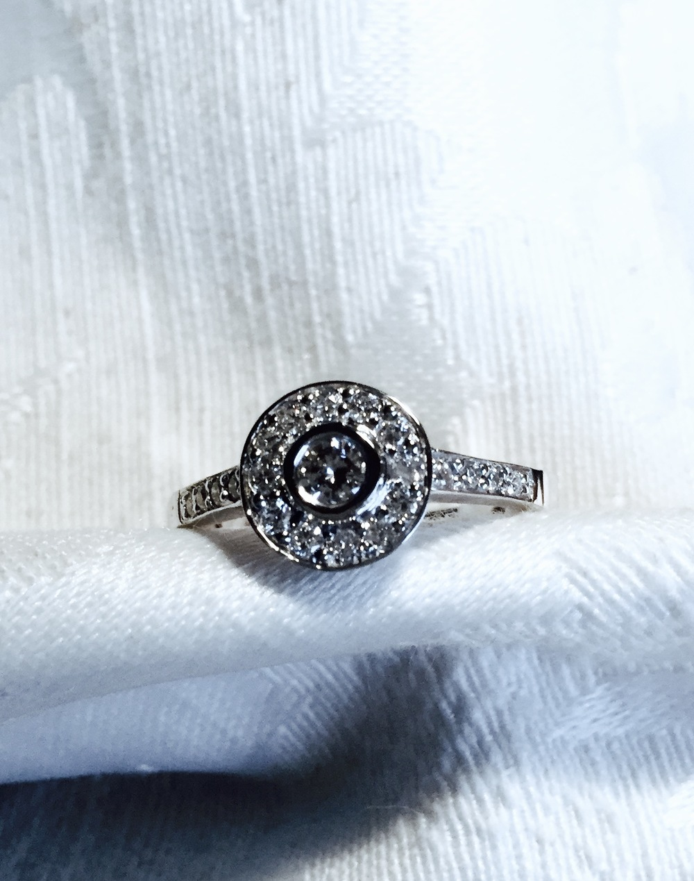 Original Engagement ring round stone reset into halo