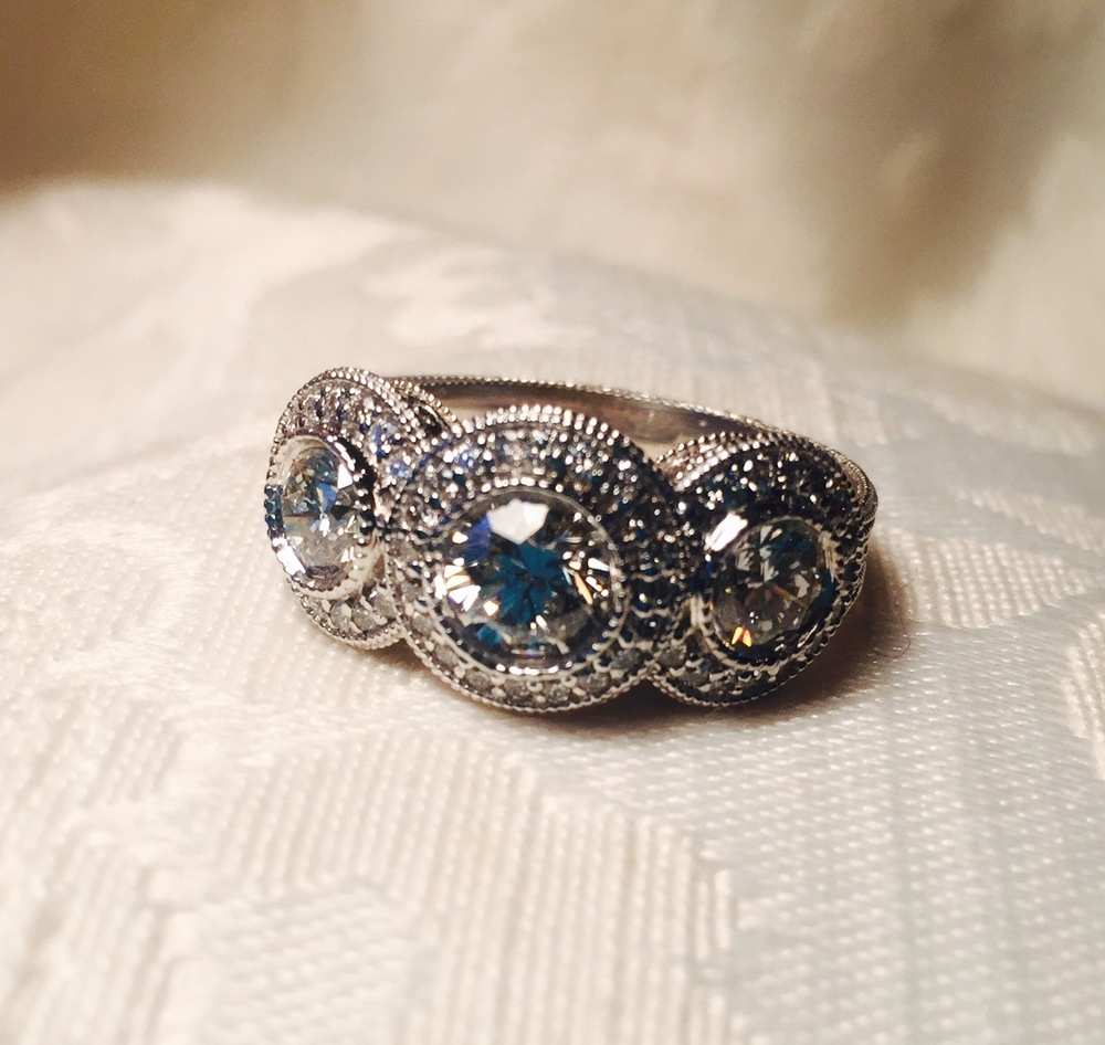 Mother's and her own original engagement ring with an added third diamond