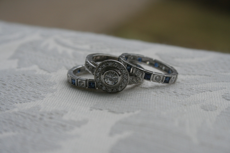 Original engagement stone in center and combined sapphire and diamond earrings along with some other pieces of jewelry to create 3 beautiful stack engagement/wedding rings.