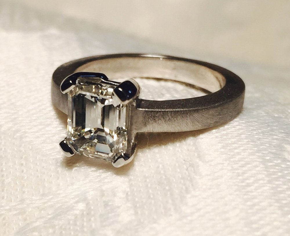 Custom made platinum ring and supplying 1.50 carat GIA certified emerald cut diamond.