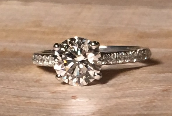 Custom made engagement ring supplying center 2 carat GIA certified diamond.