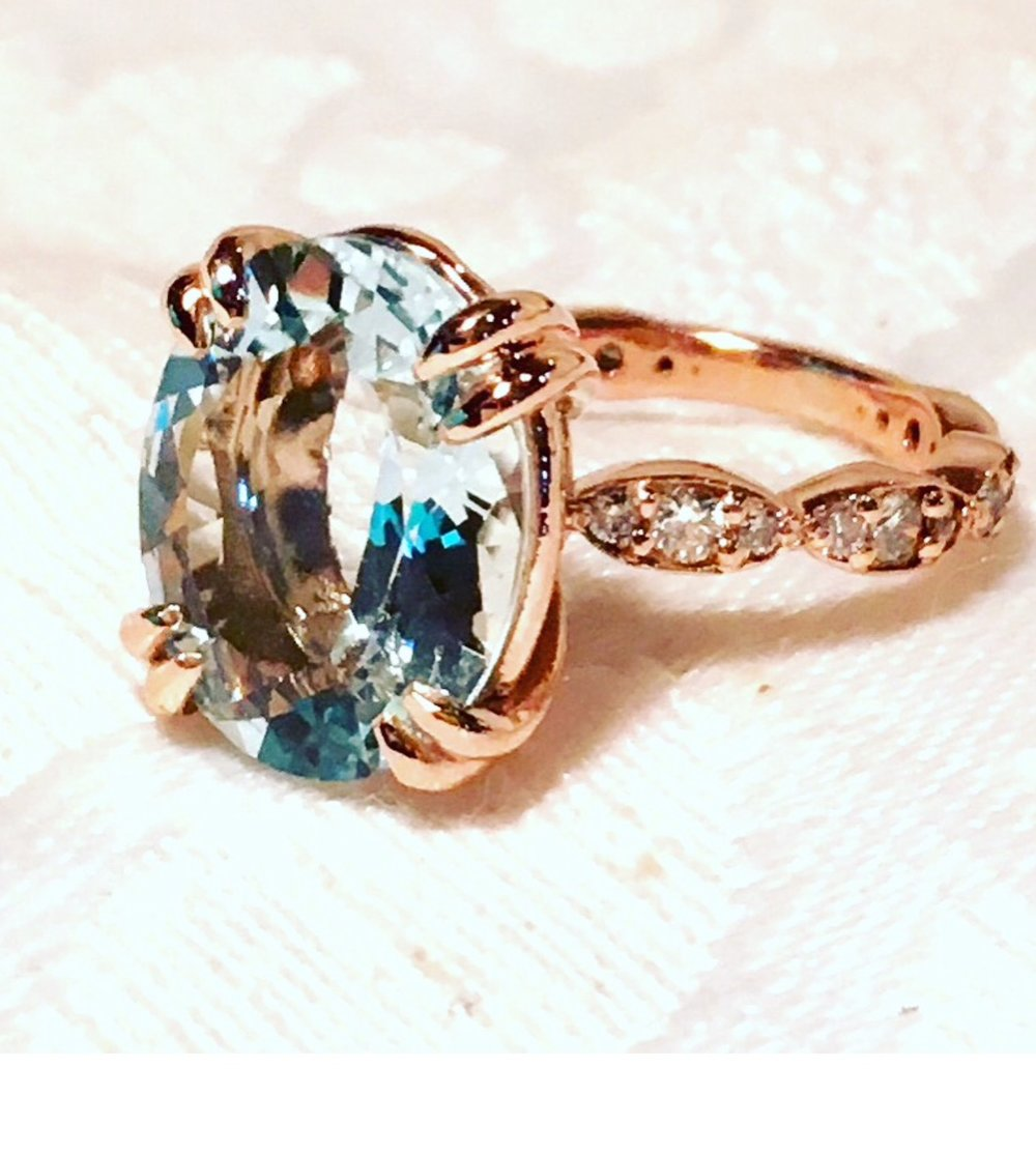 Custom made supplying this 4 carat oval aquamarine stone and designed this 14k rose gold moutning.