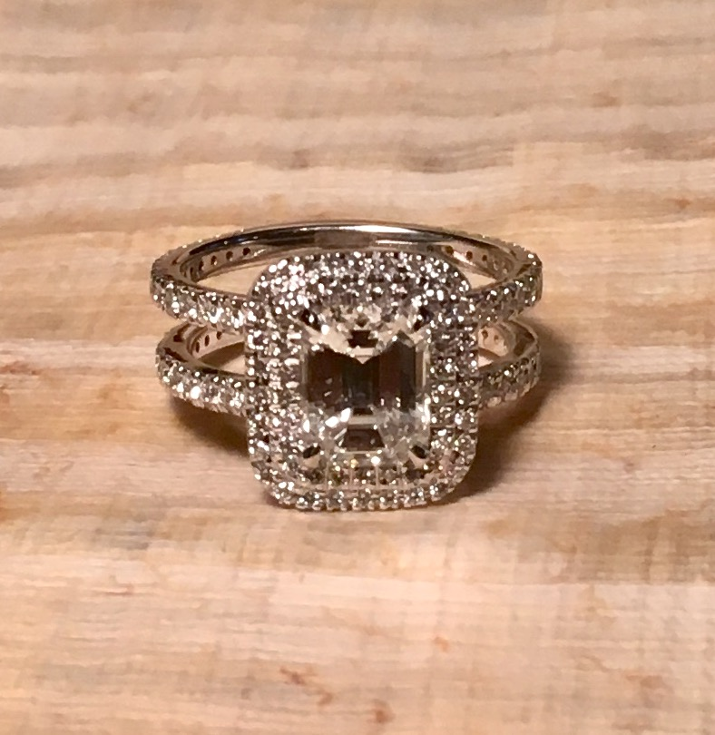 Custom made ring supplying this 2 carat GIA certified emerald cut diamond, designed this ring to slide and hold the wedding band in the middle in the future.
