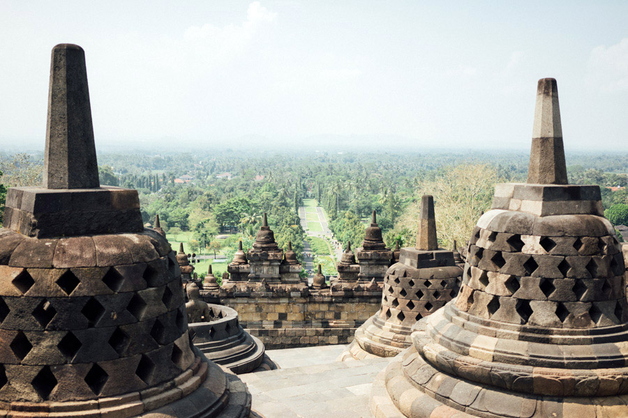 The beautiful stupas at the top of Borobudur, with the grand park below. Admission to this UNESCO site is a bit high, but once you see how well the grounds are maintained, and the amount of work that was and continues to be done for the restoration and upkeep of the temple, you'll see why.