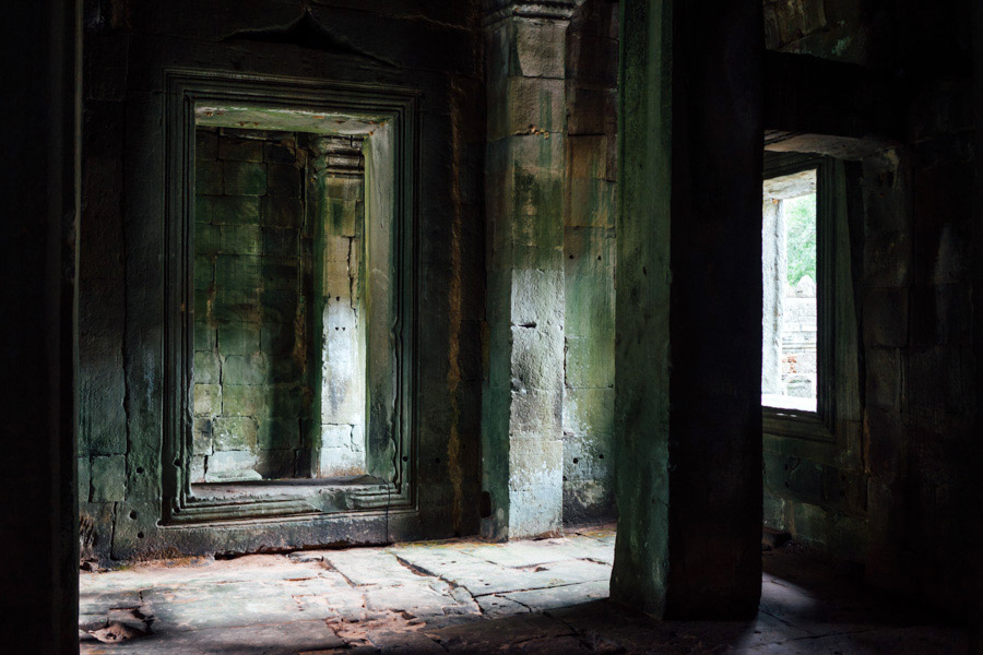 Preah Kahn Temple - One of Alex's favorite temples, for its setting within the forest and the unrestored ruins being overtaken by giant trees. I love this place for its walls and pockets of light. We could spend more time here...