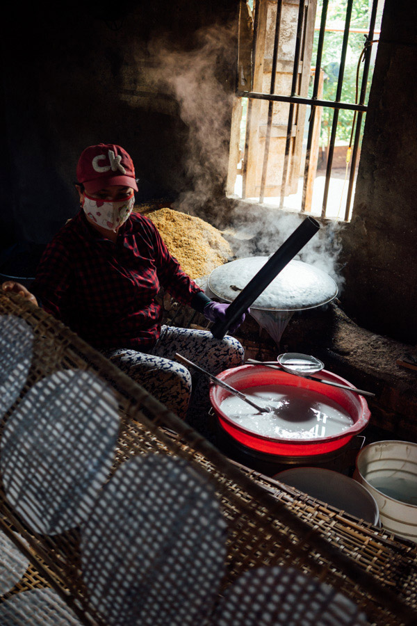 Observing the slow, hot, beautiful craft of making delicate rice paper.