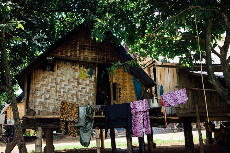 Between our rides from Da Lat through Lak Lake, Buon Ma Thuot, and Nha Trang, we stopped at a few minority villages. This term was new to us, as we learned that there are 53 ethnic minorities that make up 12% of the population in Vietnam. The minority people live simply, in small wood or bamboo dwellings, only receiving a primary education (depending on where they live), and gathering food from the lakes and forests on a daily basis.