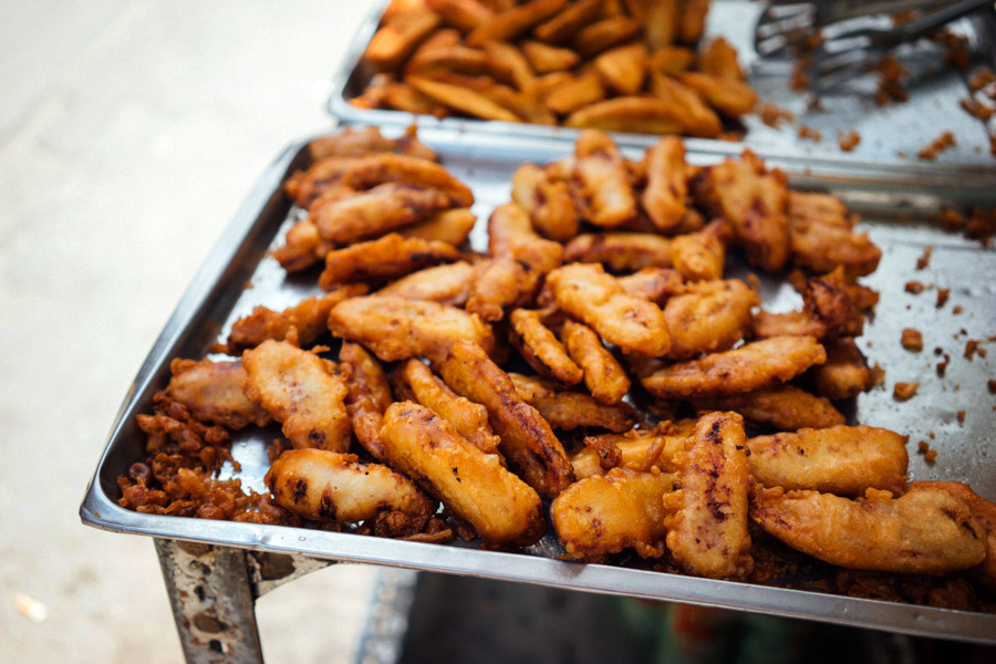 Fried bananas battered in a rice flour mixture that gives the perfect crust. All fritters should be made this way.