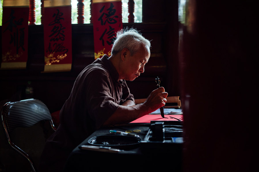 A calligraphist quietly at work at the Temple of Literature.
