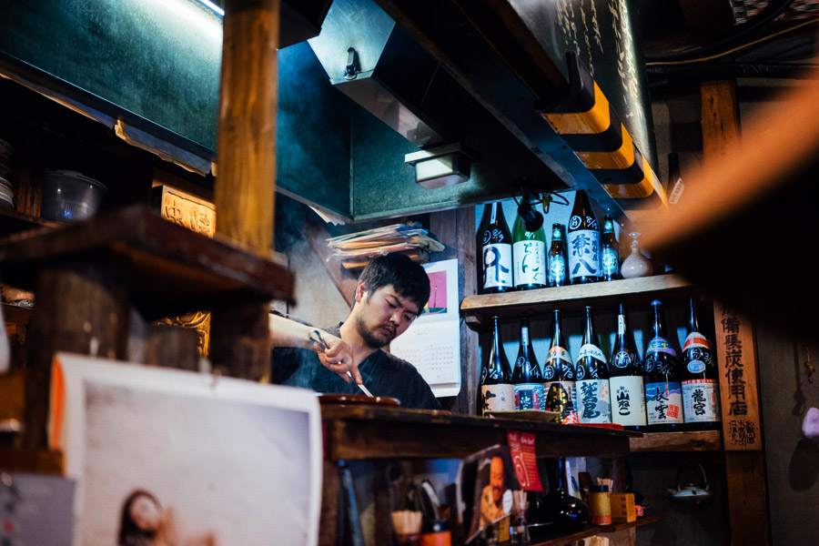 Our yakitori chef behind the grill. Loved the feel of this place... Old wood, sake bottles, and smoke permeating the air.