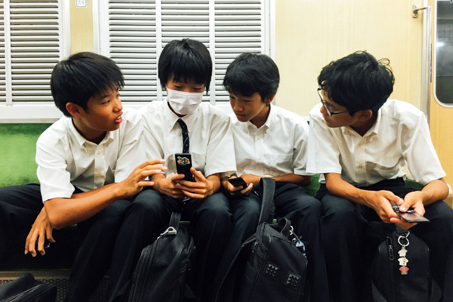 Japanese school boys on the train.