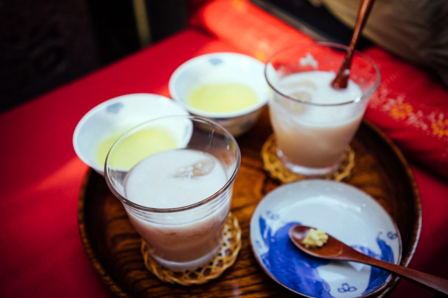 Nourishing cups of cold amazake, a fermented rice drink served with a pinch or two of grated ginger. Imagine a sweet drinkable porridge over ice, with little bits of freshly grated ginger.