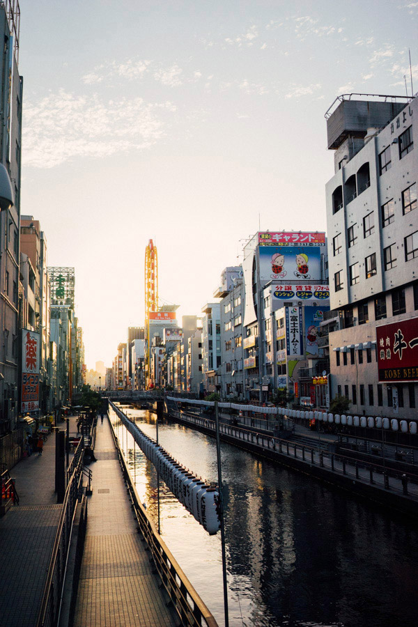 We didn't know much about Osaka when we booked our tickets, but it has quickly stolen our hearts with its food, its people, its pace, and its scenic river walks. (Alex said it reminded him of Lyon.) Here's a much busier side of town, albeit still charming at golden hour.