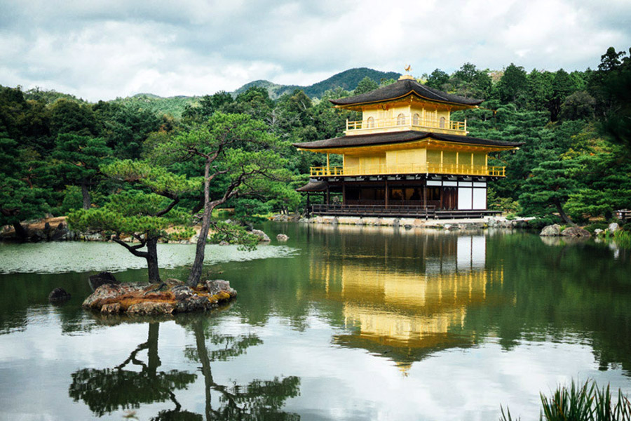 Kinkaku-ji's story is one of rebirth. The original 500+ year old structure was burned in 1950 when a young monk attempted suicide. Five years later it was rebuilt, covered in gold to purify the temple of negative thoughts about death, and crowned with a golden phoenix. No wonder it's one of Kyoto's most visited sites.