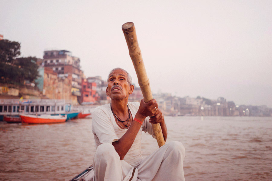 Steering the row boat along the Ganges. There are 84 ghats along the river, 2 of which are dedicated to cremation. Here we are on our way to visiting both.