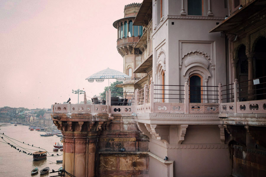 Beautiful architecture along the Ganges in Varanasi, India, basking in the early morning haze.