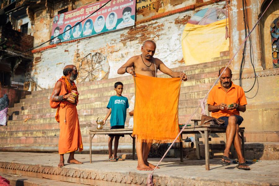 Men preparing to bathe in the Ganges.