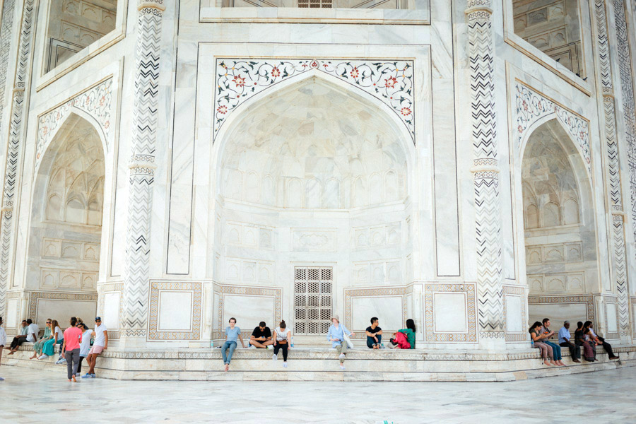 We can't imagine how many pieces of white marble were used to construct this masterpiece, but even more, the time it took to intricately lay all the floral tile work and calligraphy of the Taj Mahal. Just look at the scale of things!