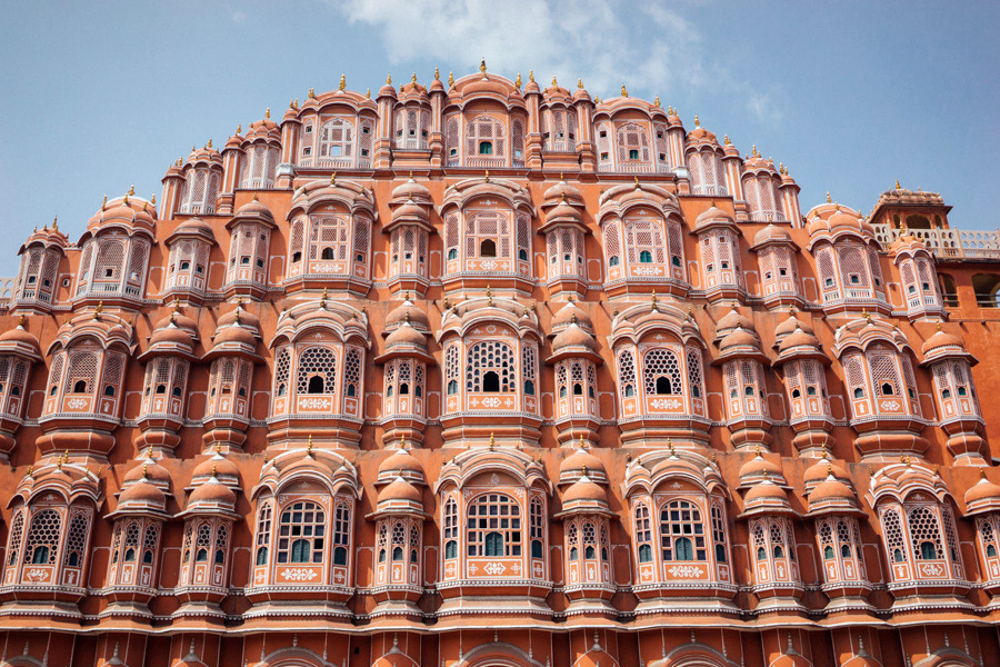 The iconic facade of Hawa Mahal was built for royal women to observe street life, unseen from above. At only 15 meters high it's constructed from the pretty red and pink sandstone that gives Jaipur its nickname: The Pink City.
