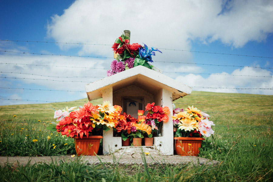 We've seen countless roadside memorials traveling through South America, but this was the first time we could stop the car so I could take a photo. There's a strange vibrancy on this large, quiet island full of colorful churches, decorated cemeteries, and bright markers like this one.
