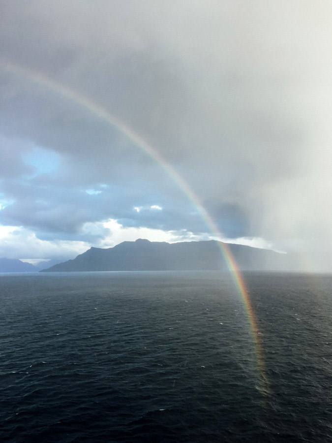 A rainbow starting right at the foot of our ship.