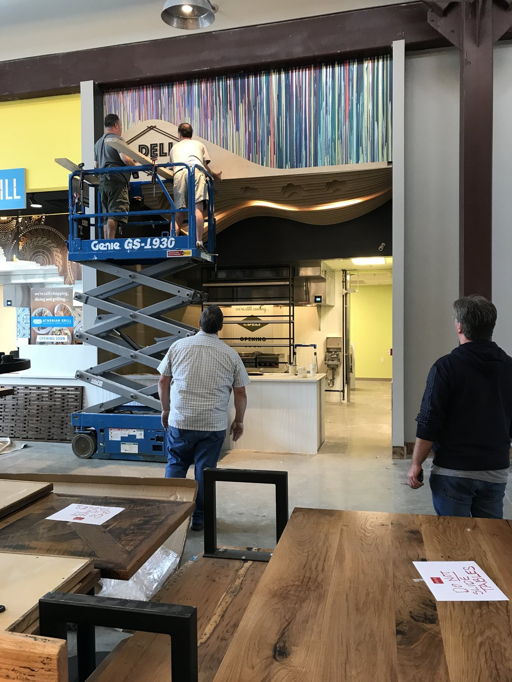 Installing Sarah Heller's beautiful mural panels along with the Deli sign