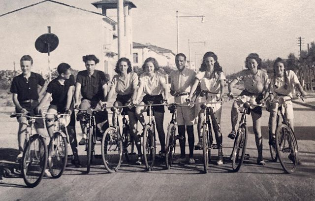 This one's our favorite from the 1930s. The three Vittori #sisters (Rori fourth from left, Adriana second from right, and Miry on the right) and their friends bicycle around town. Adriana describes how much she loved biking as a girl and the feeling of #independence and #freedom it gave her, as well as how much she liked wearing pants or shorts. She remembers that the young people weren't allowed to go off alone- here their Zio (Uncle) Gastone stands in the middle as a chaperone. Sometimes their mother Agnese would accompany them on long biking #adventures in the surrounding area. Agnese wasn't a very good cyclist, however; they'd often leave her behind as she couldn't keep up! 👧🏼🚲🔮🌞🇮🇹 Read the full story + #travel tips on our blog globalportals.wordpress.com #globalportals #portaltopietrasanta #vintage #versilia #oldschool #tuscany #italy #toscana #pietrasanta #italia #bicycle #retro #sun #summer #bike #throwback #tbt #family #goodvibes #sky #feminist #women #history