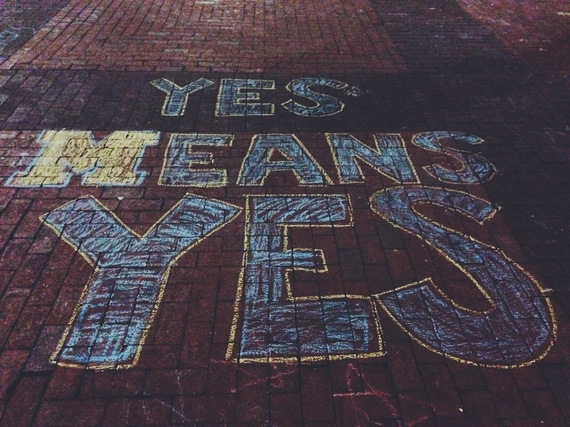 """Yes Means Yes"" chalked on the sidewalk at University of Michigan"