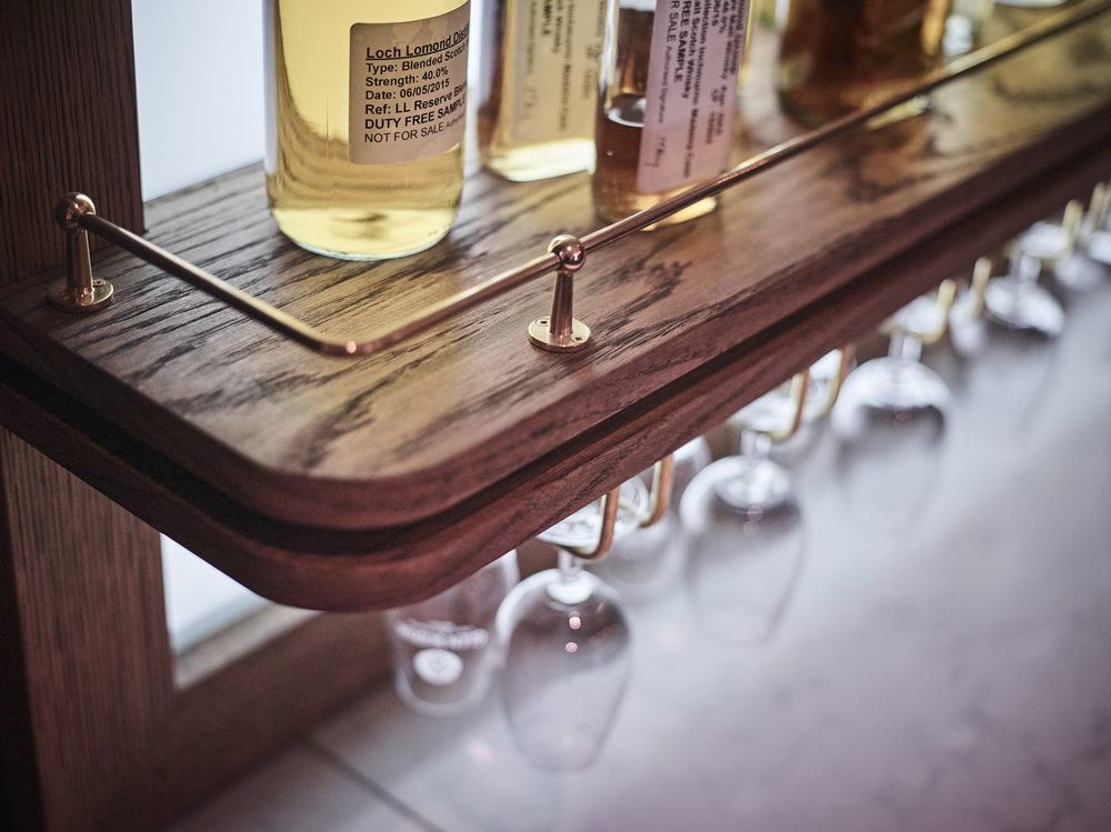 James Strong Tasting Room Single Sample Bottle Shelf Detail.jpg