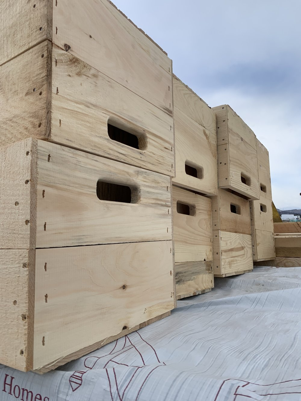 A delivery of fresh new apple crates from our friends at Clifford's Lumber.