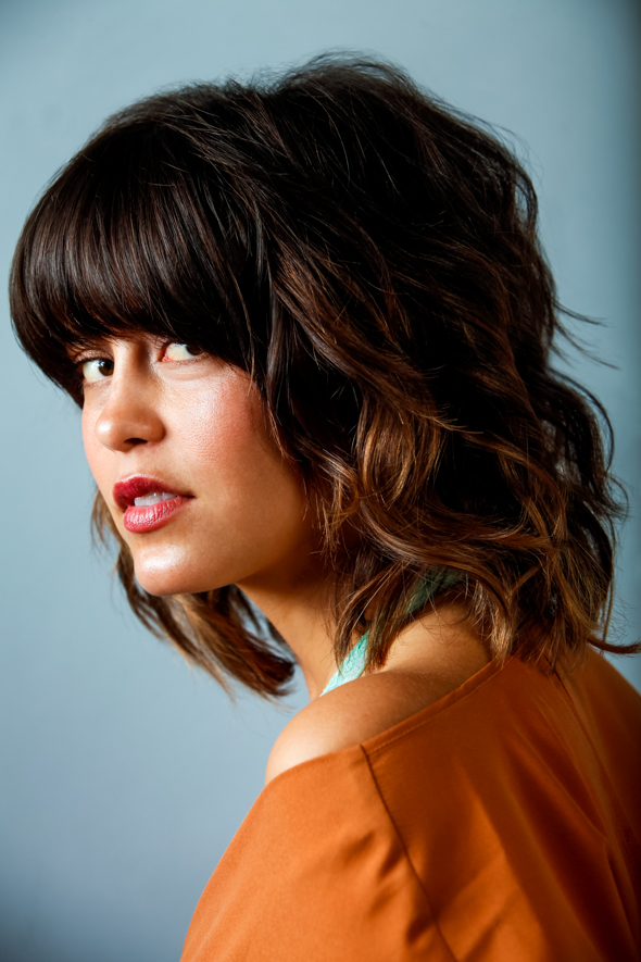 Christina is rocking this shaggy lob shape with fringe and a dewey natural makeup look created with products found in Siren Apothecary.