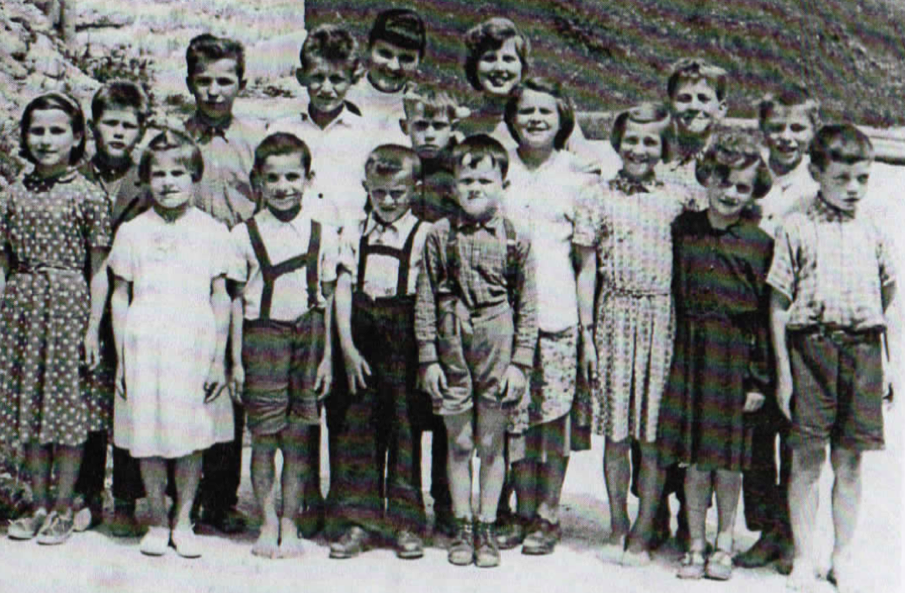 Metod (Ted) is without shoes, the fifth child from the left.