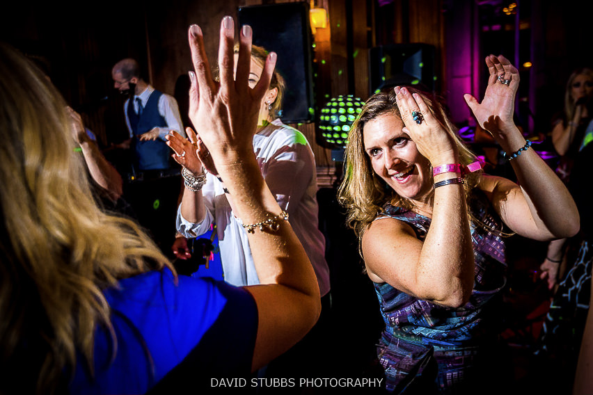 PICTURE OF DJ ADAM CARR PLAYING 'AIR PIANO' WHILST DJ'ING AT VICKY AND CHRIS'S THORNTON MANOR WEDDING. PHOTO CREDIT TO MANCHESTER WEDDING PHOTOGRAPHER. DAVID STUBBS.