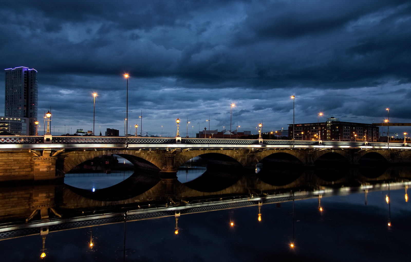 Reflecting on Queens Bridge by Geoff McGrath