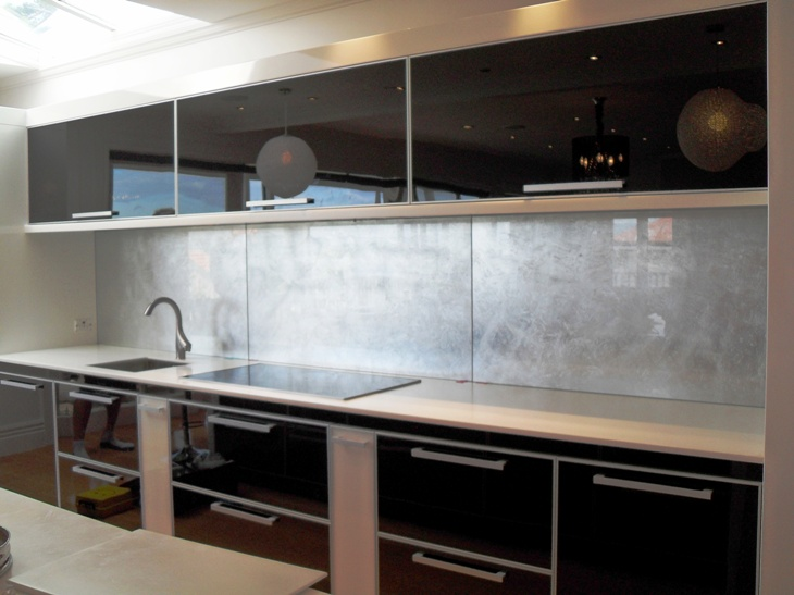 Kitchen Splash Back, in silver-leaf behind glass.