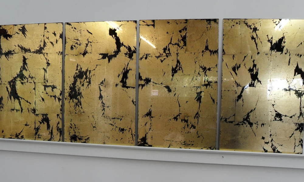 Imitation gold-leaf behind acrylic sheet. Used in casinos, bars or as a splash back. When some glamour is required.